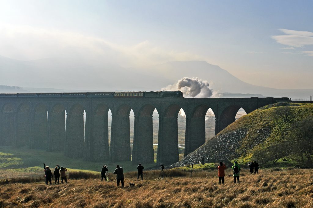 The Tornado steam train travelling over the Ribblehead Viaduct. Image courtesy of Stuart Petch.